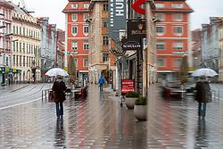 21.03.2020, Innenstadt, Graz, AUT, Coronavirus in Österreich, Die Österreichische Bundesregierung hat die verhängten Ausgangsbeschränkungen bis zum 13. April 2020 verlängert. Im Bild eine Spaziergängerin mit Regenschirm im Regen in der herrengasse in Graz // A stroller in the rain in the Herrengasse in Graz. The Austrian government extended the measures and laws to contain and spread dthe Corona Virus pandemic until April 13 2020., in Graz, Austria on 2020/03/21. EXPA Pictures © 2020, PhotoCredit: EXPA/ Erwin Scheriau