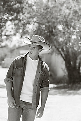 handsome young cowboy outdoors
