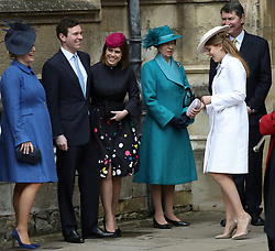 Members of the Royal family, Zara Tindall (left) Princess Eugenie and her fiance Jack Brooksbank, the Princess Royal and her husband Vice Admiral Sir Timothy Laurence and Princess Beatrice (second right) wait for Queen Elizabeth II to arrive for the Easter Mattins Service at St George's Chapel, Windsor Castle, Windsor.