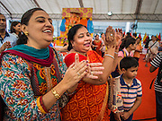 07 SEPTEMBER 2014 - BANGKOK, THAILAND: Women pray during the Ganesh Festival at Central World in Bangkok. Ganesh Chaturthi, also known as Vinayaka Chaturthi, is a Hindu festival dedicated to Lord Ganesh. It is a 10-day festival marking the birthday of Ganesh, who is widely worshiped for his auspicious beginnings. Ganesh is the patron of arts and sciences, the deity of intellect and wisdom -- identified by his elephant head. The holiday is celebrated for 10 days, in 2014, most Hindu temples will submerge their Ganesh shrines and deities on September 7.     PHOTO BY JACK KURTZ