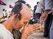 "31 JANUARY 2013 - PHNOM PENH, CAMBODIA: A Cambodian woman has her head shaved while mourning the death of former Cambodian King Norodom Sihanouk. In Cambodia, the spouse and the children mourn the death of their husband or father by shaving their heads, and many Cambodian women have shaved their heads recently because Sihanouk was revered as the father of the nation. Norodom Sihanouk (31 October 1922 - 15 October 2012) was the King of Cambodia from 1941 to 1955 and again from 1993 to 2004. He was the effective ruler of Cambodia from 1953 to 1970. After his second abdication in 2004, he was given the honorific of ""The King-Father of Cambodia."" Sihanouk served two terms as king, two as sovereign prince, one as president, two as prime minister, as well as numerous positions as leader of various governments-in-exile. He served as puppet head of state for the Khmer Rouge government in 1975-1976. Most of these positions were only honorific, including the last position as constitutional king of Cambodia. Sihanouk's actual period of effective rule over Cambodia was from 9 November 1953, when Cambodia gained its independence from France, until 18 March 1970, when General Lon Nol and the National Assembly deposed him. Upon his final abdication, the Cambodian throne council appointed Norodom Sihamoni, one of Sihanouk's sons, as the new king. Sihanouk died in Beijing, China, where he was receiving medical care, on Oct. 15, 2012. His funeral procession, which will wind through Phnom Penh is Friday, Feb.1 and his cremation is on Feb. 4, 2013. Over a million people are expected to attend the service.     PHOTO BY JACK KURTZ"
