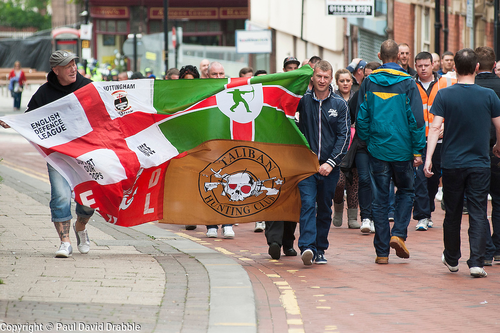 """Rotherham England<br /> 13 September 2014 <br /> EDL supporters from Nottigham approach  Rotherham Town Hall before the start of the English Defence Leagues Justice for the Rotherham 1400 March on Saturday Afternoon described by an EDL Facebook Page as """"a protest against the Pakistani Muslim grooming gangs"""" on Saturday Afternoon <br /> <br /> <br /> Image © Paul David Drabble <br /> www.pauldaviddrabble.co.uk"""