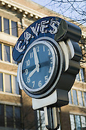 old clock and name of store in downtown Little Rock Arkansas with building in background