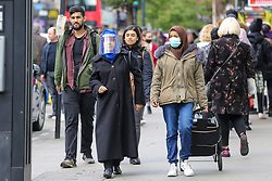 © Licensed to London News Pictures. 11/10/2020. London, UK. A woman wearing a face shield in Wood Green, north London as another national coronavirus lockdown looms. <br /> SADIQ KHAN, Mayor of London has warned that a London lockdown cannot be ruled out as coronavirus cases in the capital soar. In a statement to MPs on Monday, 12 Oct 2020, Prime Minister Boris Johnson is expected to announce tougher local restrictions, outlining plans for a three-tier system, where each region in England is placed into a tier based on the severity of cases in the area. Photo credit: Dinendra Haria/LNP