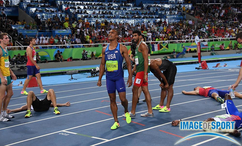 Aug 18, 2016; Rio de Janeiro, Brazil; Ashton Eaton (USA) celebrates after running 4:23.33 in the decathlon 1,500m during the 2016 Rio Olympics at Estadio Olimpico Joao Havelange. Eaton tied the Olympic record to win with 8,893 points.