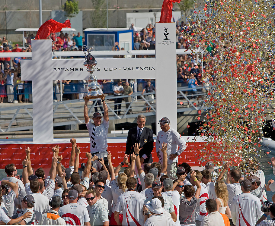 Pierre Yves Firmenich, president of the Societe Nautique de Geneve, is handing the America's Cup to Ernesto Bertarelli.<br /> Race 7 ALINGHI beats Emirates Team New Zealand by 1 second and wins the America's Cup <br /> 32nd America's Cup, 2007<br /> Valencia, Spain<br /> © Daniel Forster