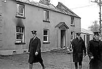 Assassination of Senator Billy Fox, 35 years, Protestant, Fine Gael politician, Co Monaghan, Rep of Ireland, 12th March 1974. He was previously a TD (Irish MP).  Fox was visiting the home near Clones of his fiancee which unknown to him had been taken over by thirteen armed paramilitaries. He ran from the scene but was followed and shot dead in a nearby field. Irish police at the crime scene with Senator Fox's fiancee's burnt-out house in the background. Five members of the Provisional IRA were subsequently tried and convicted of the killing. 197403120163h.<br />