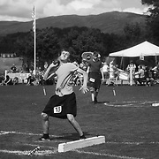 Highland Games, 3rd of August 2019, Newtonmore, Scotland, United Kingdom. A boy compete in the strong man competition for juniors. The Highland Games is a traditional annual event where competitors compete as strong men, runners, dancers, pipers and at tug-of-war. The games go back centuries and are happening through-out the summer across Scotland. The games are both an important event locally and a global tourist attraction.