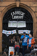 Local campaigners protest the closure by Lambeth council on the front steps of Carnegie Library, Herne Hill, south London. The angry local community in the south London borough have occupied their important resource for learning and social hub. After a long campaign by locals, Lambeth have gone ahead closed the library's doors for the last time the day before, because they say, cuts to their budget mean millions must be saved. A gym will replace the working library and while some of the 20,000 books on shelves will remain, no librarians will be present to administer it. London borough's budget cuts mean four of its 10 libraries will either close, move or be run by volunteers.