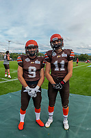 KELOWNA, BC - AUGUST 17:  Tyson MASTRODIMOS #9 and Adam Burton #11 of Okanagan Sun pose for a photo at the sidelines during warm up against the Westshore Rebels  at the Apple Bowl on August 17, 2019 in Kelowna, Canada. (Photo by Marissa Baecker/Shoot the Breeze)