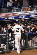 San Francisco Giants manager Bruce Bochy (15) congratulates third baseman Conor Gillaspie (21) after scoring a run against the Chicago Cubs during Game 4 of the NLDS at AT&T Park in San Francisco, Calif., on October 11, 2016. (Stan Olszewski/Special to S.F. Examiner)