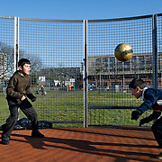 "Nederland Utrecht 31 januari 2009 20090131 Foto: David Rozing ..Serie vogelaarwijk Kanaleneiland .Reportage documentary on deprived area / projects "" Kanaleneiland "" This area is on a list with projects which need help of the government because of degradation in the area etc.Jongens spelen buiten, voetballen .Boys playing soccer.islamic, project, suburb, suburbian, problem. Neighboorhood, neighboorhoods, district, city, problems, multicultural, immigrant, immigrants, cultural diversity, daily life, kids..Foto: David Rozing"