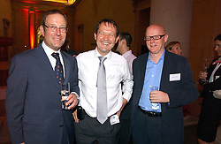 Left to right, RICHARD DESMOND, SIMON WALKER and DAVID YELLAND at the Reuters Summer Party held in The Sackler Octagon, Tate Britain, Millbank, London SW1 on 27th July 2006.<br /><br />NON EXCLUSIVE - WORLD RIGHTS