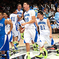 031613  Adron Gardner/Independent<br /> <br /> The Laguna Acoma Hawks explode behind Dexter Demon Uriel Jimenez (15), left, to claim the 2A New Mexico High School Basketball title at The Pit in Albuquerque Saturday.<br /> The Hawks beat the Demons in the championship game 51-39.