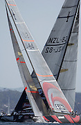 Alinghi crosses ahead of Team New Zealand on the first beat of race two.America's Cup 2003. 16/2/2003 (© Chris Cameron 2003)