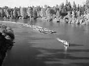 9969-6770. Tugboat and log raft on Willamette River near Newberg. November 4, 1946.