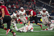 Kyle O'bannon #3 of the Iraan High School football team breaks free during the state championship game at AT&T Stadium in Arlington, Texas on December 15, 2016. (Cooper Neill for The New York Times)