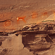 Ancient pictographs painted onto the sandstone by long vanished Ancestral Puebloans (Anasazi) in Canyon de Chelly NM