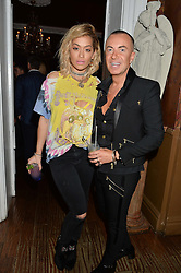 RITA ORA and JULIEN MACDONALD at a dinner for JF London x Kyle DeVolle held at Beach Blanket Babylon, Ledbury Road, London on 29th September 2016.