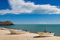 Fishing boats sit on sandy beach at Sea of Cortez, San Felipe, Baja California, Mexico