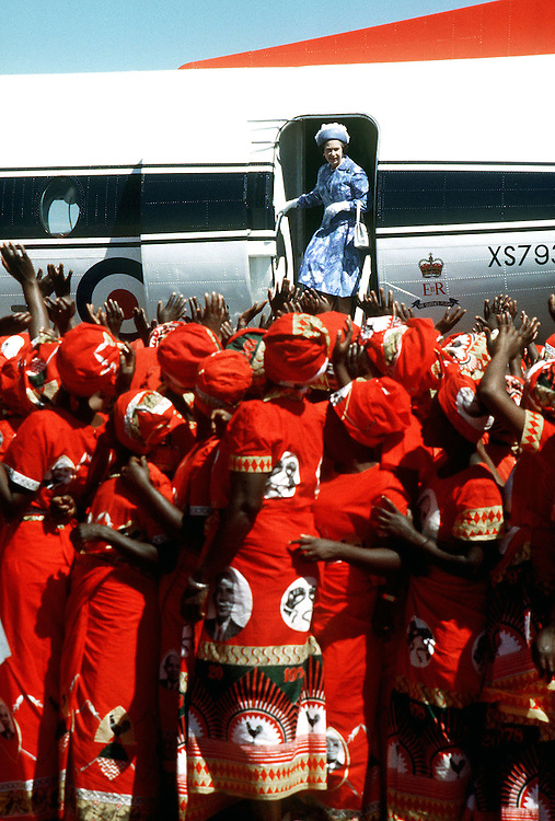 The Queen on the steps of the Royal flight as she departs from a visit to Malawi, Africa in July 1979. Photograph by Jayne Fincher