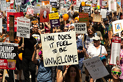 """© Licensed to London News Pictures . 13/07/2018. London, UK. Placard reading """" How does it feel to be unwelcome """" . Demonstrators march from Portland Place to Trafalgar Square in protest against US President Donald Trump's UK visit . Photo credit: Joel Goodman/LNP"""