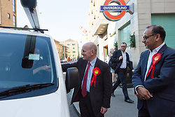 © Licensed to London News Pictures. 11/06/2015. London, UK. Labour Tower Hamlets Mayor candidate, JOHN BIGGS (centre) canvassing in Tower Hamlets, east London. Tower Hamlets residents go to the polls today to vote for a new Mayor of Tower Hamlets after Lutfur Rahman was removed from office for fraud and corrupt practices by an election court earlier this year. Photo credit : Vickie Flores/LNP