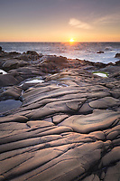 Sunset over eroded sandstone and Tafoni formations, Sonoma Coast, Salt Point State Park California