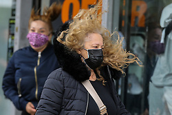 © Licensed to London News Pictures. 21/05/2021. London, UK. Windy conditions for shoppers in Wood Green, north London. Strong winds and heavy rain are forecast for many parts of the UK today. Photo credit: Dinendra Haria/LNP