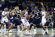 HIGH POINT, NC - JANUARY 06: Charleston Southern's Travis McConico (1) and Jamaal David (0) guard High Point's Jahaad Proctor (center). The High Point University of Panthers hosted the Charleston Southern University Buccaneers on January 6, 2018 at Millis Athletic Convocation Center in High Point, NC in a Division I men's college basketball game. HPU won the game 80-59.