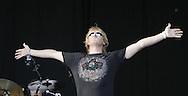 photograph2 Joe Elliott of Def Leppard greets the crowd at the Cove on Friday night.  Bryan Adams' performance followed Def Leppard. Santiago Flores/ photo/news 080506