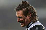 Jeff Hassler of the Ospreys reacts in pain after taking a knock. European Rugby Champions Cup, pool 2 match, Ospreys v Northampton Saints at the Liberty Stadium in Swansea, South Wales on Sunday 17th December 2017.<br /> pic by  Andrew Orchard, Andrew Orchard sports photography.