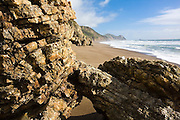Striated and uplifted rock formations along Wildcat Beach, Point Reyes National Seashore, California.