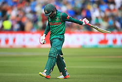 Bangladesh's Shakib Al Hasan leaves the field after being caught by India's MS Dhoni during the ICC Champions Trophy, semi-final match at Edgbaston, Birmingham.