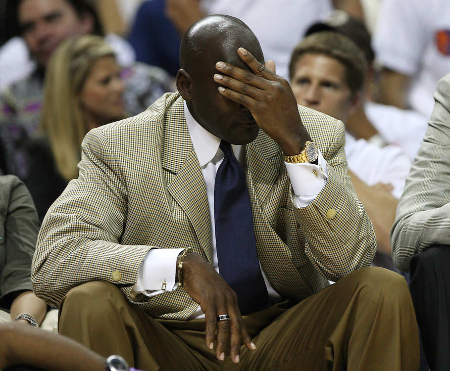 CHARLOTTE - APRIL 24:  Charlotte Bobcats owner Michael Jordan wipes his forehead while watching the action during Game Three of the Eastern Conference Quarterfinals between the Charlotte Bobcats and the Orlando Magic during the 2010 NBA Playoffs at Time Warner Cable Arena on April 24, 2010 in Charlotte, North Carolina. NOTE TO USER: User expressly acknowledges and agrees that, by downloading and/or using this photograph, user is consenting to the terms and conditions of the Getty Images License Agreement.  (Photo by Mike Zarrilli/Getty Images) *** Local Caption *** Michael Jordan