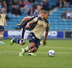Leeds United's Lee Peltier takes the ball away from Millwall's Martyn Waghorn - Photo mandatory by-line: Robin White/JMP - Tel: Mobile: 07966 386802 28/09/2013 - SPORT - FOOTBALL - The Den - Millwall - Millwall V Leeds United - Sky Bet Championship