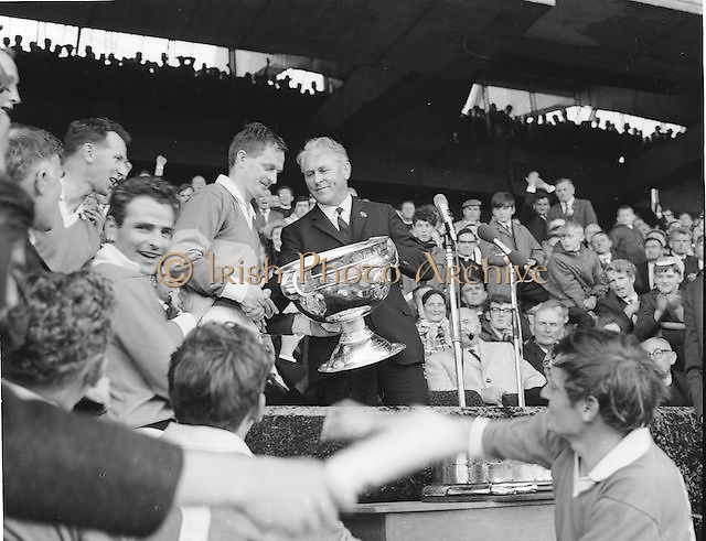 Kerry captain J Culloty and team mates rejoice in their victory as GAA President Seamus O' Riain presents him with the Sam Maguire after the All Ireland Senior Gaelic Football Final Kerry v Offaly in Croke Park on 28th September 1969. Kerry 0-10 Offaly 0-7.
