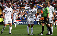 Photo: Paul Thomas. <br /> Bolton Wanderers v Newcastle United. Barclays Premiership. 11/08/2007. <br /> <br /> Bolton players (L-R) Kevin Nolan, Gary Speed and Gavin McCann dis-agree with referee Mr C Foy.