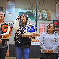 020114       Cayla Nimmo<br /> <br /> Jennifer Nez, a member of the 1994 women's basketball championship team, holds their trophy and cheers while her fellow teammates and coaches are honored at Gallup High during halftime of the Gallup Bengals and Miyamura Patriots game.