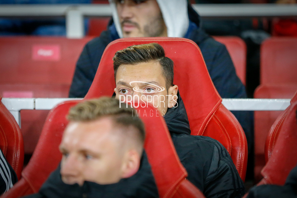 Arsenal midfielder Mesut Özil (10) on the bench during the Europa League match between Arsenal and Eintracht Frankfurt at the Emirates Stadium, London, England on 28 November 2019.