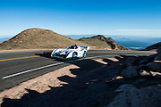 June 26-30 - Pikes Peak Colorado. runs his car during practice for the 91st running of the Pikes Peak Hill Climb.