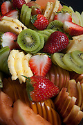 Freshly cut fruit salad with kiwi, pineapple, strawberries and melon