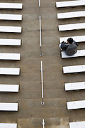 A lone Purdue fan sits in the stands before the inaugural Heart of Dallas Bowl against Oklahoma State at Cotton Bowl Stadium at Fair Park in Dallas, Texas, on January 1, 2013.  (Stan Olszewski/The Dallas Morning News)