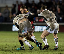 Dragons' Harrison Keddie under pressure from Glasgow Warriors' Adam Ashe<br /> <br /> Photographer Simon King/Replay Images<br /> <br /> Guinness PRO14 Round 14 - Dragons v Glasgow Warriors - Friday 9th February 2018 - Rodney Parade - Newport<br /> <br /> World Copyright © Replay Images . All rights reserved. info@replayimages.co.uk - http://replayimages.co.uk