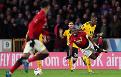 Manchester United's Paul Pogba reacts to a challenge from Wolverhampton Wanderers' Willy Boly during the FA Cup quarter final match at Molineux, Wolverhampton.