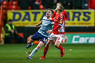 Charlton Athletic midfielder Chris Solly (20) defends the ball from Accrington Stanley midfielder Sam Finley (14) during the EFL Sky Bet League 1 match between Charlton Athletic and Accrington Stanley at The Valley, London, England on 19 January 2019.