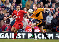 Photo. Jed Wee.<br /> Liverpool v Wolverhampton Wanderers, FA Barclaycard Premiership, Anfield, Liverpool. 20/03/2004.<br /> Liverpool's Milan Baros (L) and Wolves' Jody Craddock try to win possession.