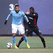 NEW YORK, NEW YORK - March 12:  Ethan White #3 of New York City FC is challenged by Patrick Nyarko #12 of D.C. United during the NYCFC Vs D.C. United regular season MLS game at Yankee Stadium on March 12, 2017 in New York City. (Photo by Tim Clayton/Corbis via Getty Images)
