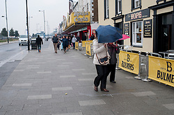 (c) Licensed to London News Pictures. 20/04/2014 Essex, UK. After a promising start the the Easter Weekend, Southend on Sea saw wind and rain. A popular destination saw only a few hardy people on the seafront. Local traders depend on good weather to bring out the crowds. Photo credit Simon Ford/LNP