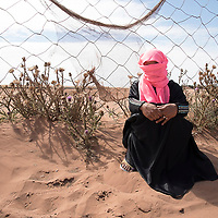 """Amina has a child and works in tomato fields close to Ait Aimera. She works for different companies and  is hired day by day. She goes to work in a track. She happened to be sexually harassed. """"It is quite common here. It is part of the job""""."""
